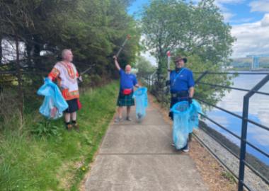 Tour Leaders Michael, John & Stewart collecting litter